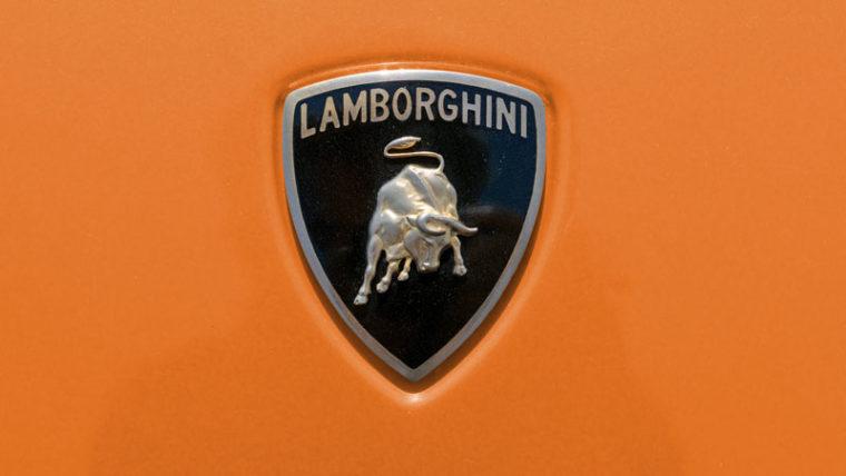 Roberto Lusso / Shutterstock.com Royalty-free stock photo ID: 702105577 TURIN, ITALY - JUNE 10, 2017: Lamborghini logo on a orange car body