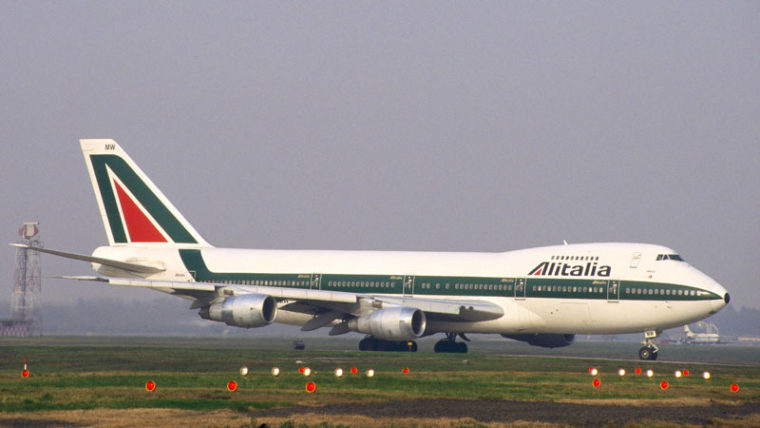 An Alitalia Boeing 747 taxing near the runway