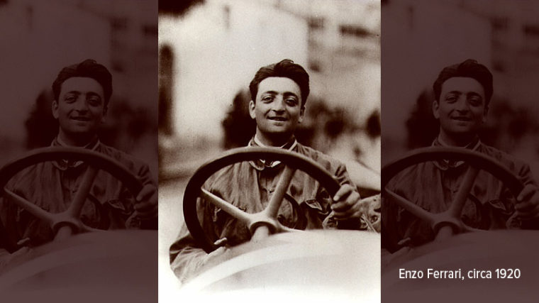 A smiling young Enzo Ferrari at the wheel of a car