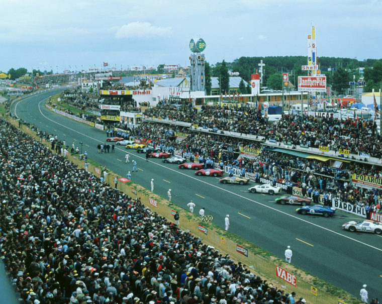 1966 Le Mans start - Henry Ford with others is walking down the track with the starting flag, drivers are getting ready to make the mad dash for their cars