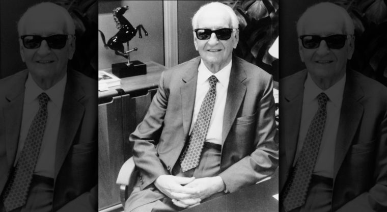 Enzo Ferrari in his office after being nominated Man of the Century by Autocar magazine